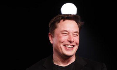 Elon Musk wears a wild grin as he climbs up the chart